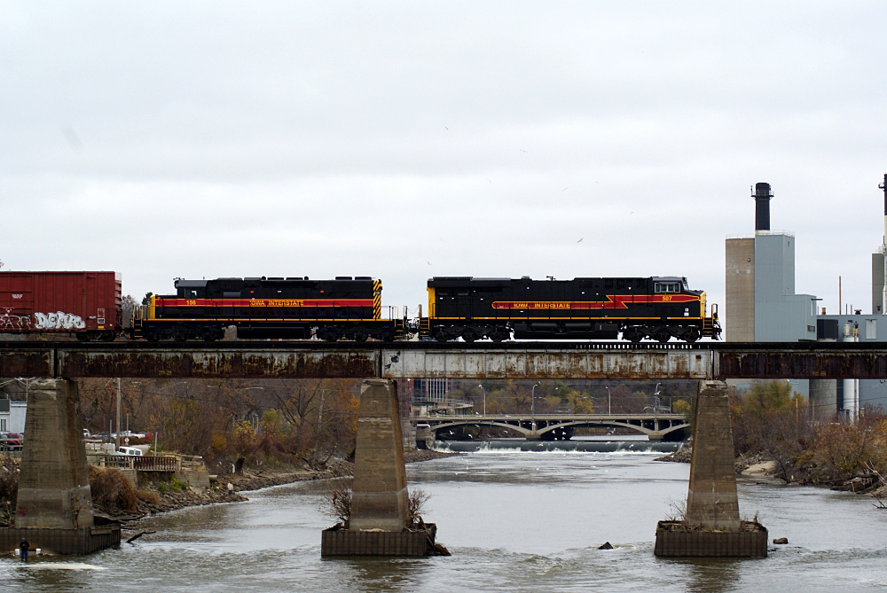 The CBBI crosses the Iowa River Bridge with 507 in charge.