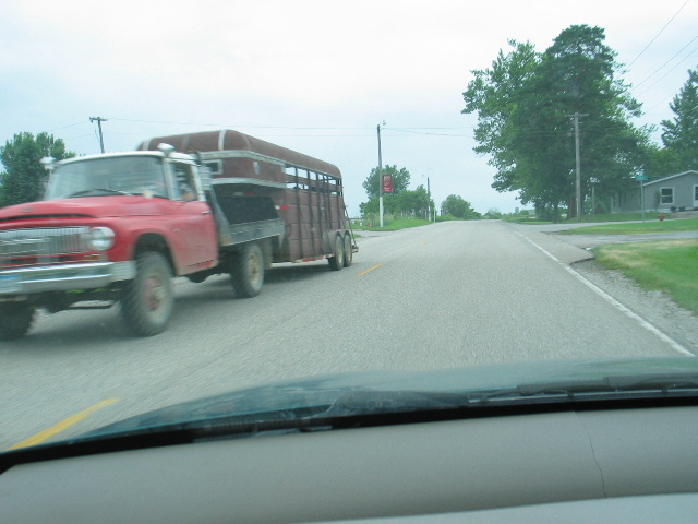 I couldn't quite get the camera ready quick enough to get this classic '66 Farmall ton 4x4 complete with spotlights (probably an old fire truck) at Stuart.  If I hadn't been in hot pursuit of a train I'd have chased this guy down and shaken his hand.