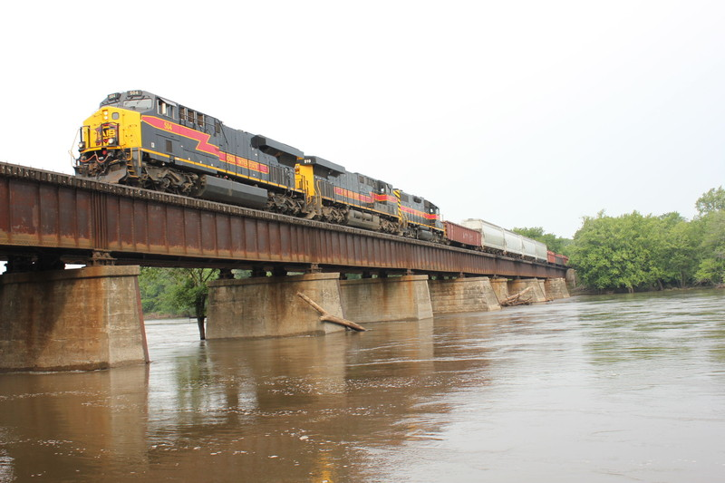 EB crosses the Cedar River, June 21, 2013.  The 700 and several head end cars will be set out at N. Star for the Wilton Local.