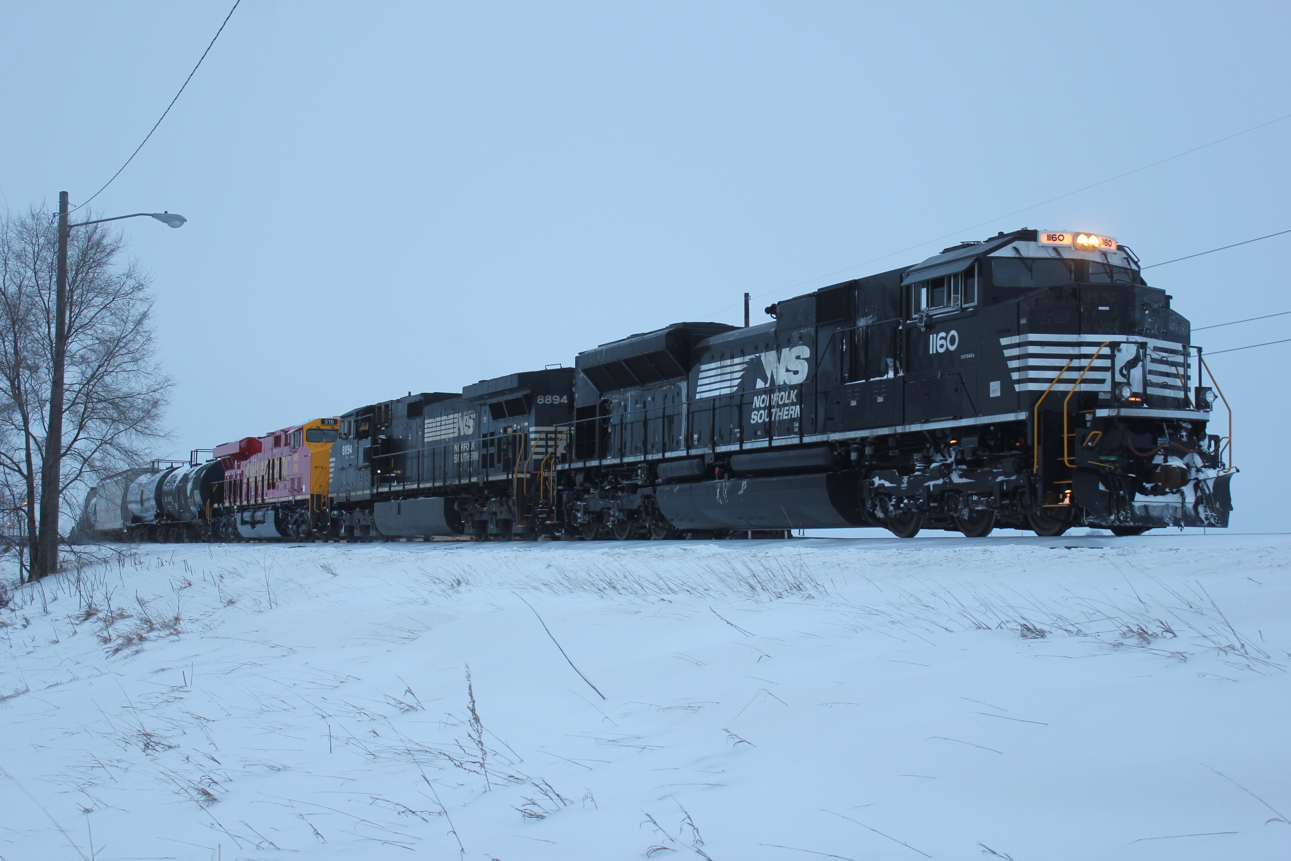 CP train 475 is working the new yard at Muscatine with a pair of NS motors for power and IAIS 516 in tow.