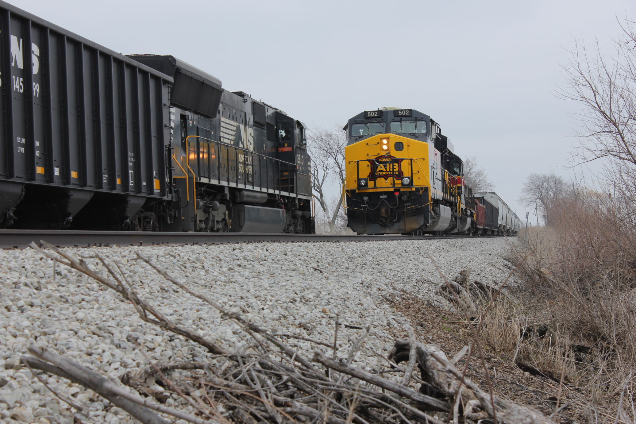 WB meets coal mtys with NS power at the east end of Walcott siding, March 28, 2014