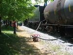 Transferring water from the tank car to the tender in Newton.