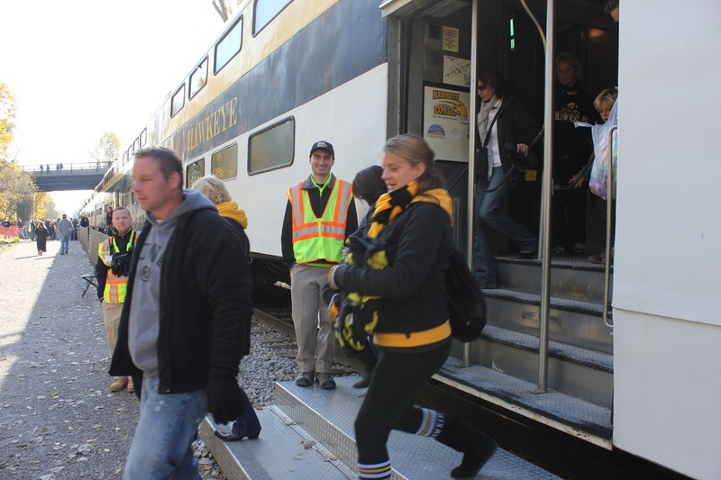 "Trainboy Alex is ""on the job"" unloading passengers at the stadium."