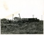 Eastbound RI freight derailed at the mp 205.5 crossing east of Wilton, Sept./Oct. 1979.