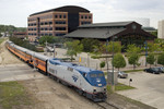 The Amtrak special heads east through downtown Moline, IL 13-May-2007.