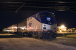 A chartered Amtrak train using MILW 261 equipment sits in BNSF's Lower Yard under the Centennial Bridge.  Rock Island, IL 12-May-2007.