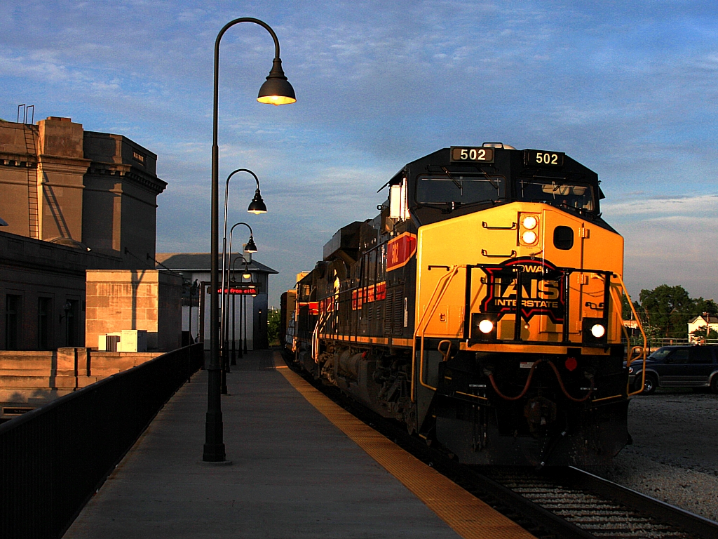 The day comes to a close as IAIS 502 passes UD Tower and Joliet's Union Station after getting the signal for bridge 407