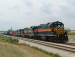 601 leads 413, 468, 401, 495 and a rebuilt GP38-3 for the newly established CF&E Railway based out of Fort Wayne, IN. This CBBI train is slowing down for a stop at Ozinga. We are at Mokena's Hickory Creek metra stop. 07-29-04