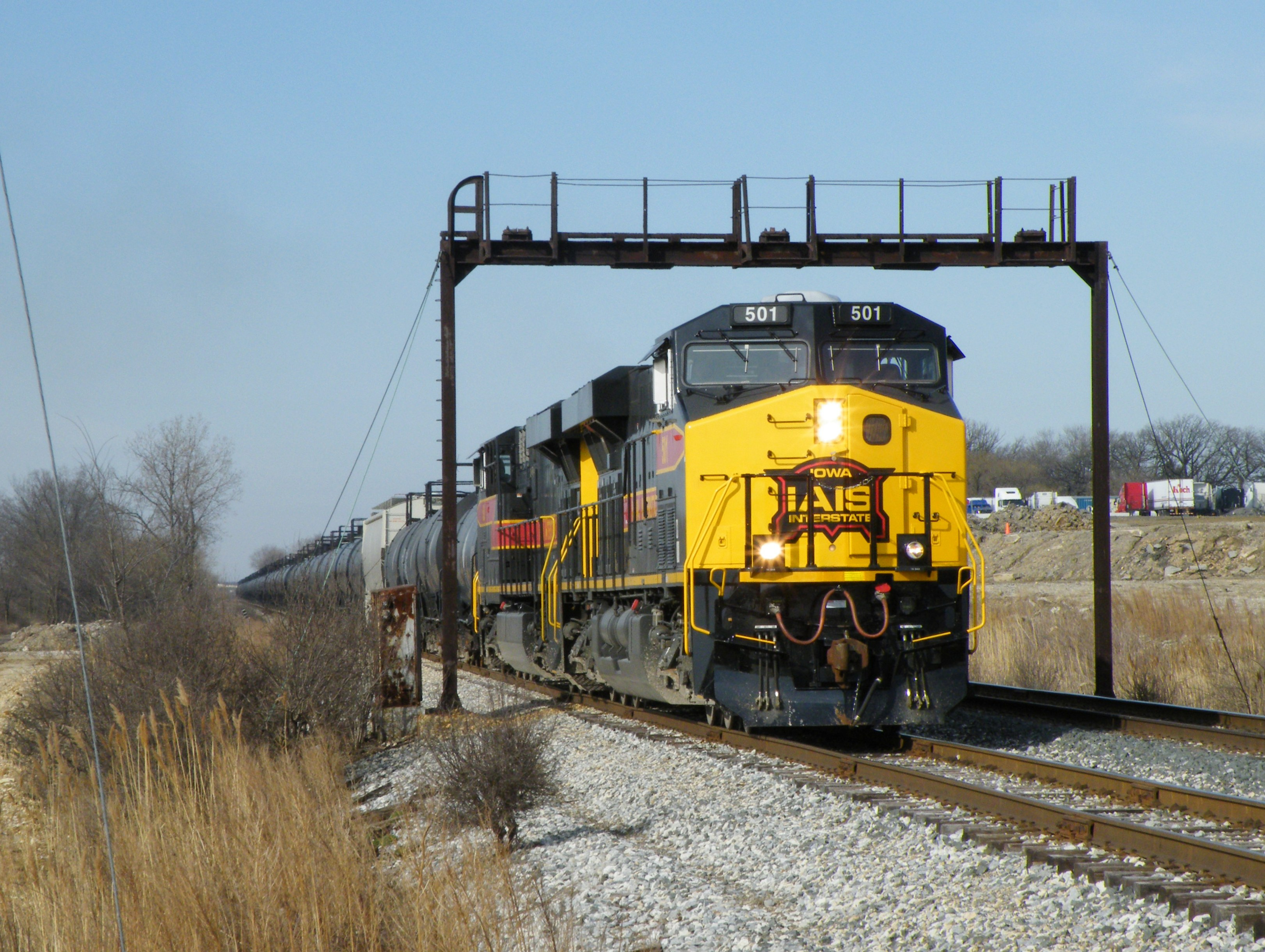 Iowa 501 leads an identical brother on a RINSU type train through the yard limits of Rockdale.