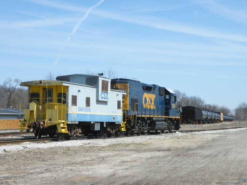 A neat C&O lettered CSX Cupola Caboose sits with the local power in the Seneca house track.