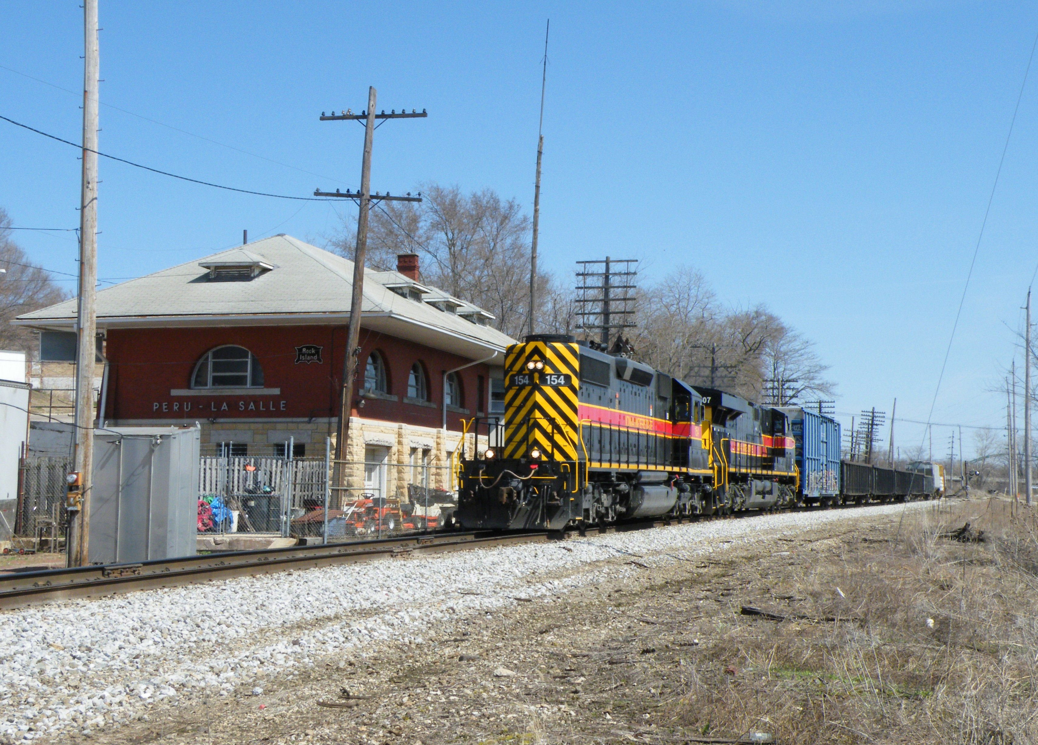 After receiving word of a second westbound departing Blue Island, I made this my last shot of Iowa 154 west and doubled back to Minooka. The train is passing the restored La Salle/Peru RI depot.