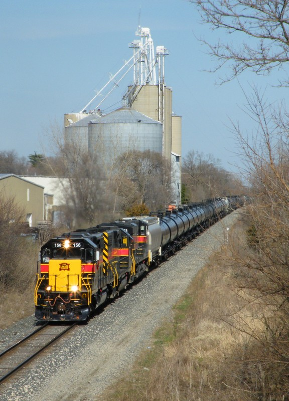 "The shot of the day, IAIS SD38-2 156 leads a BIRI ethanol train west through Minooka with a nice ""one of each"" consist. Thankfully, the engineer was an EMD fan and knew people would be out gicing chase, so he isolated the GE prior to departing Burr Oak Yd."