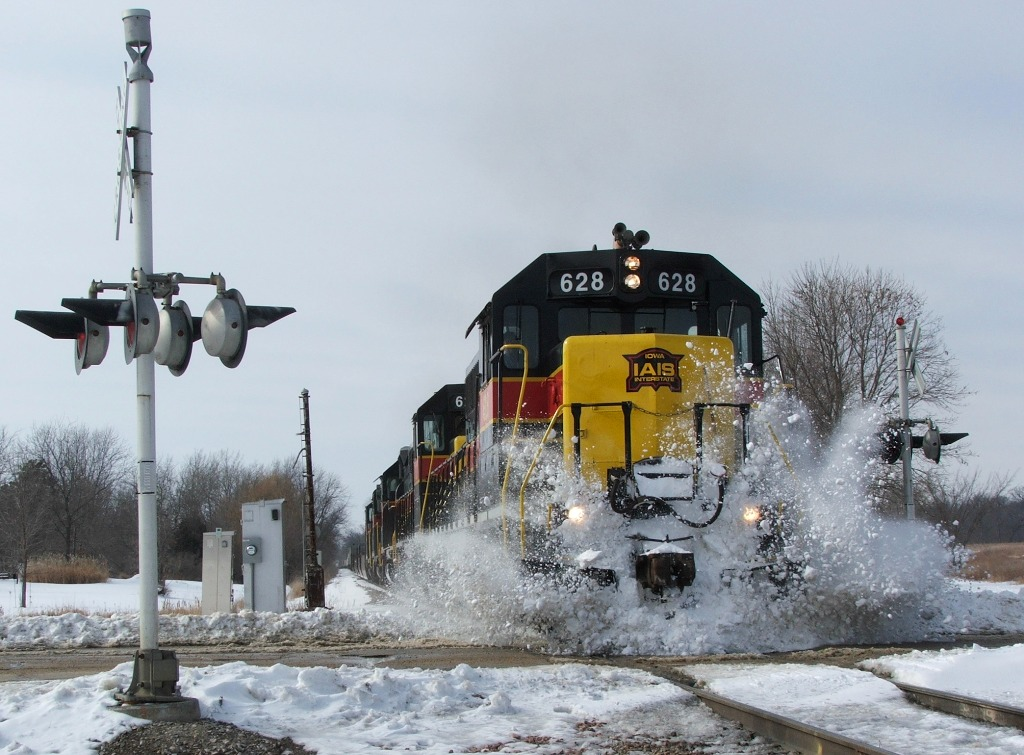 628 smacks a mini snow pile at a recently plowed grade crossing coming into Homestead.