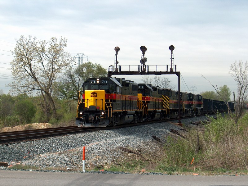 A shot of CBBI-19 on April 21st, 2005 at Houbolt Rd. in Joliet, IL making a crew change.  The Rock Island signal bridge still stands as-is today.  Photo by Joe Kaminskas.