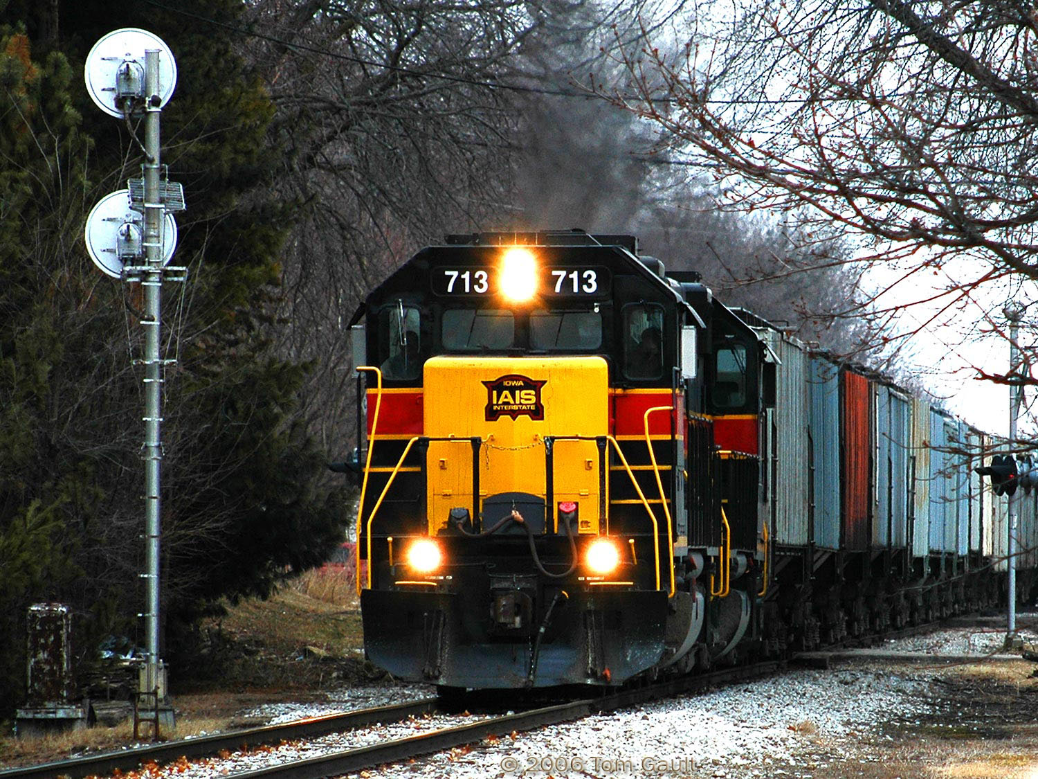 IAIS 713 West approaches the Rock Island signal protecting the Grinnell diamond after meeting the eastbound train on March 6, 2006.  Photo by Tom Gault