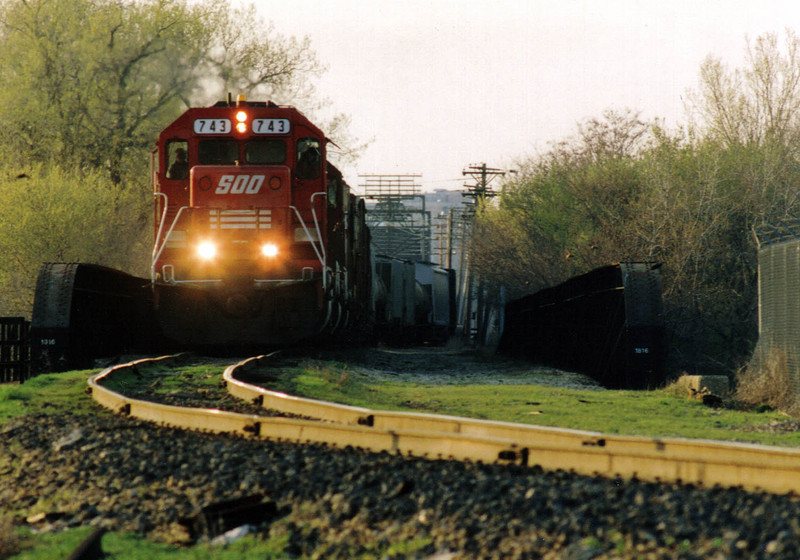 IAIS engineer Tom Frances pilots Soo 220/228 train over Arsenal Island on April 26, 1993, when Soo Line trains detoured over IAIS between Missouri Division Junction in Davenport, IA and Rock Island, IL during the Flood of 1993. Todd Pendleton #1.