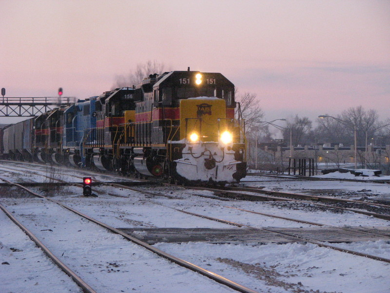 IAIS 151 heads east on the BNSF as it crosses its own railroad at Joliet, IL on 01/03/2008.  Joe Kaminskas #1.
