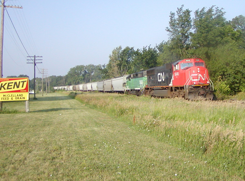 CN 5646 leads an eastbound BNSF detour at McClelland, IA on 06/24/2002.  Joe Atkinson #1.