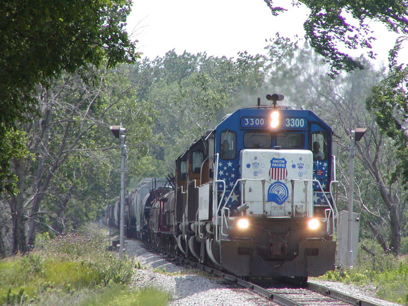 UP 3300 leads a westbound at County Hwy M16 west of Hancock, IA on 06/21/2006.  Joe Atkinson #2.