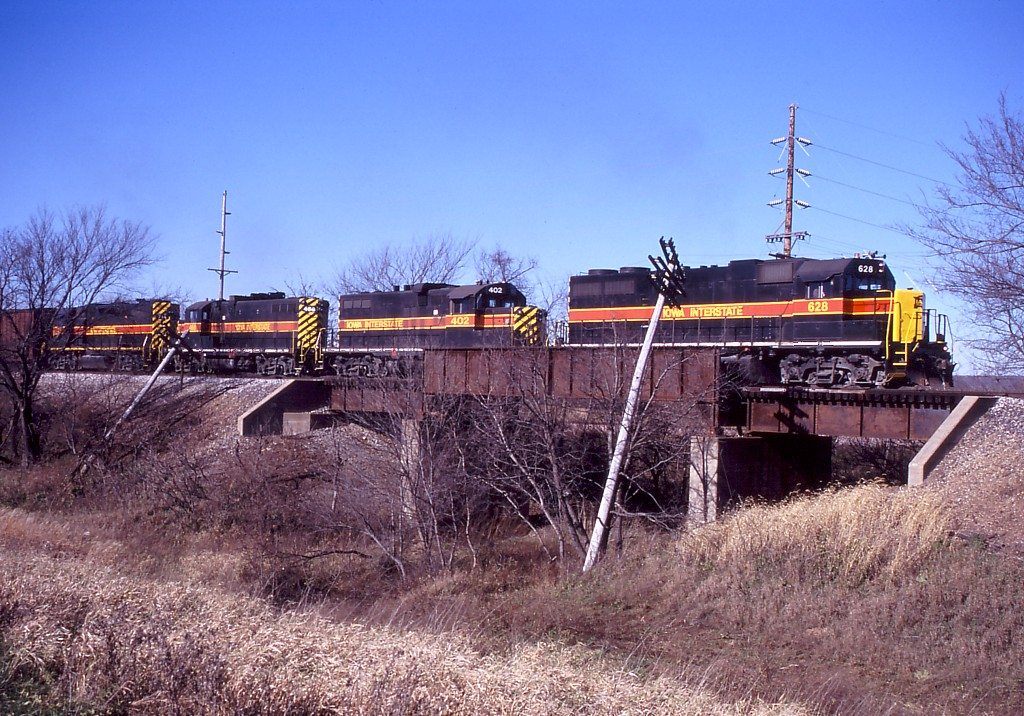 With a freshly painted nose, IAIS 628 leads CBBI over the old MILW right of way at Yocum Connection.  Photo by Will Rasmussen.