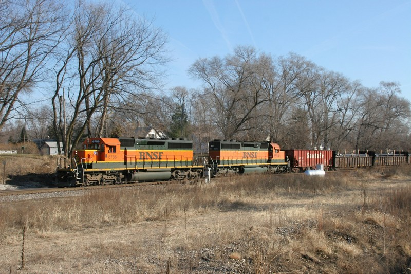 At Colona, our coal empty gets delayed again, as a northbound BNSF comes through the Colona interlocking.  In the lead are BNSF SD40-2s 6786 and 6854.
