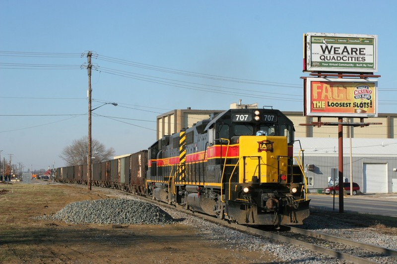 With the BNSF job and an accompanying hyrail off the track, 707 and empty head on east out of the yard.
