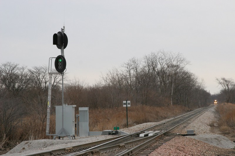 When a train approaches, they key up the radio and enter a code sequence.  The switch responds over the radio, reporting its alignment, and also clears the signal heads - all of them go green, no matter which way the switch is lined.