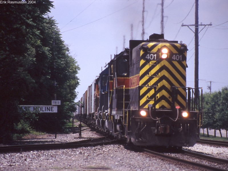 IAIS 401 East on RIPE-06 gets onto BNSF rails at 7th Street East Moline on 06-May-2004.  The IAIS mainline peels off to the left.