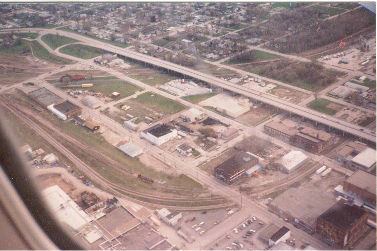 IAIS' line to the UP is seen toward the top of this photo, passing the depot and then curving west.  In the upper right corner is the Ready Mix plant that IAIS served in 2005.