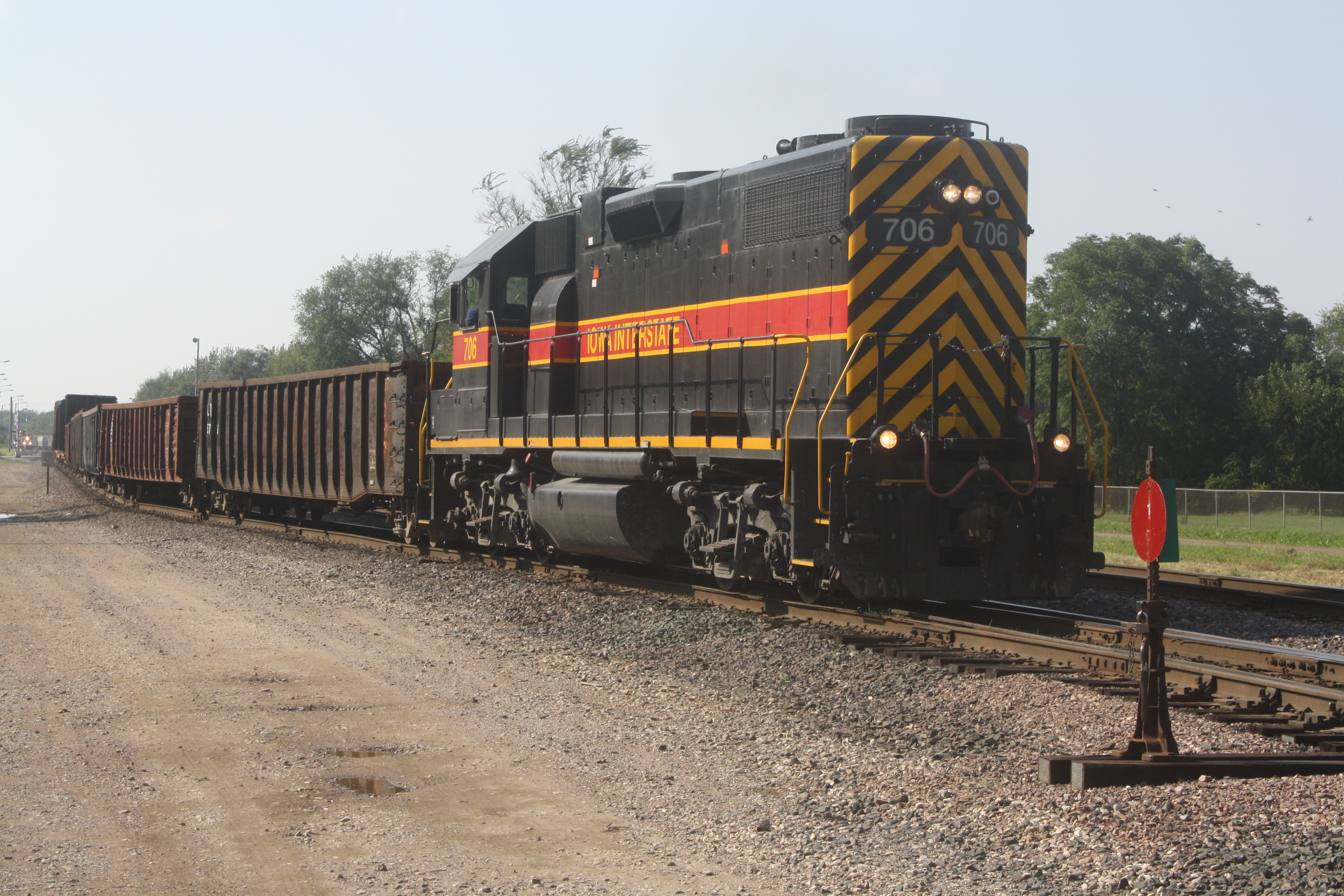 The Newton to Des Moines Area Tramp Job heads back towards Newton at Short Line Yard on 9-21-10. An EB BNSF Detour is seen in the distance.