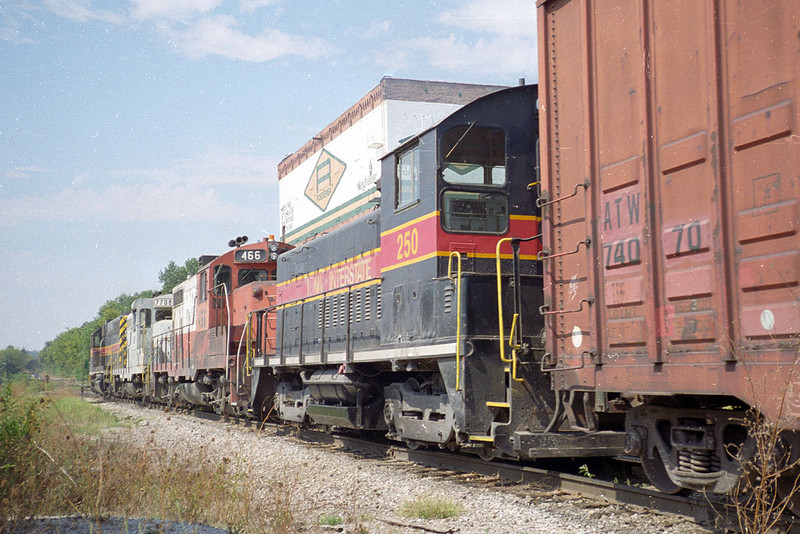 IAIS 250 tags along on BICB-03 at Taylor St in Davenport, IA.  September 4, 1999.