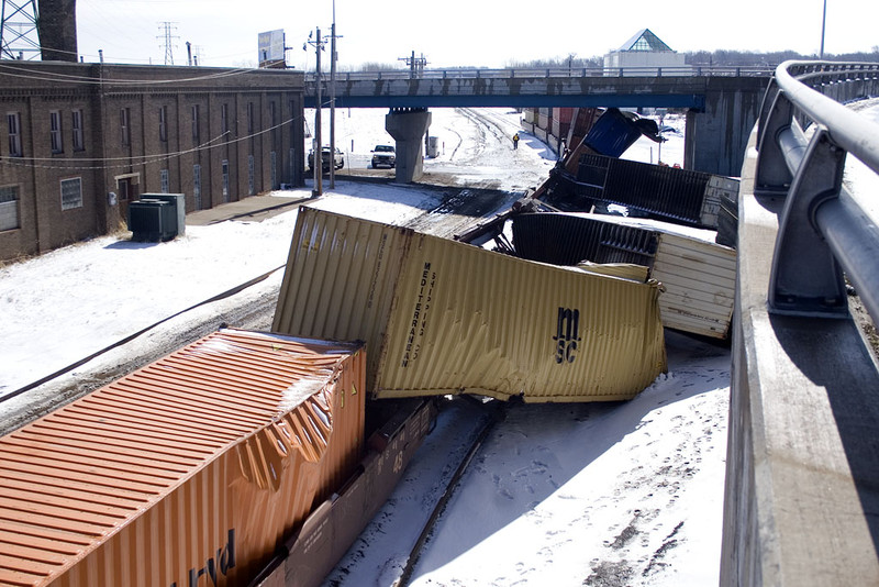 A reverse move gone wrong.  While shoving doublestacks under 24th Street in Rock Island, several of them didn't clear the bridge.  March 29, 2009.