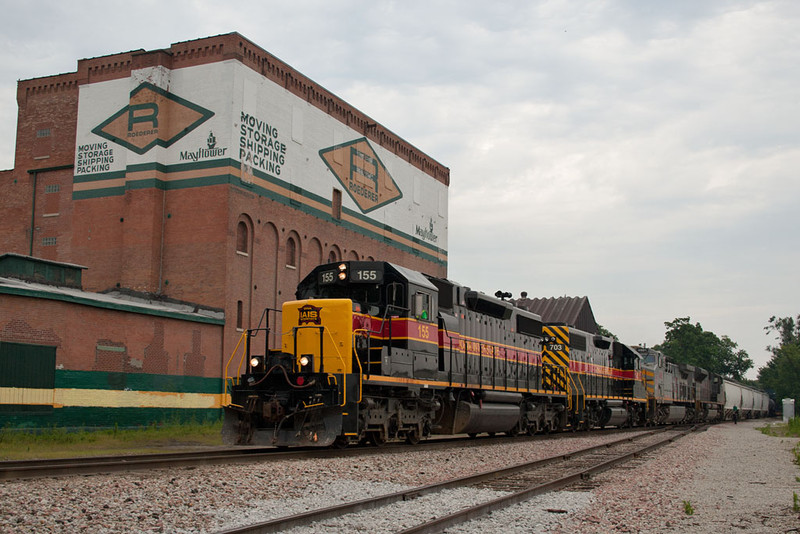 BICB-15 and a detouring KCS empty grain train are combined and head west out of Davenport, IA.  July 16, 2011.