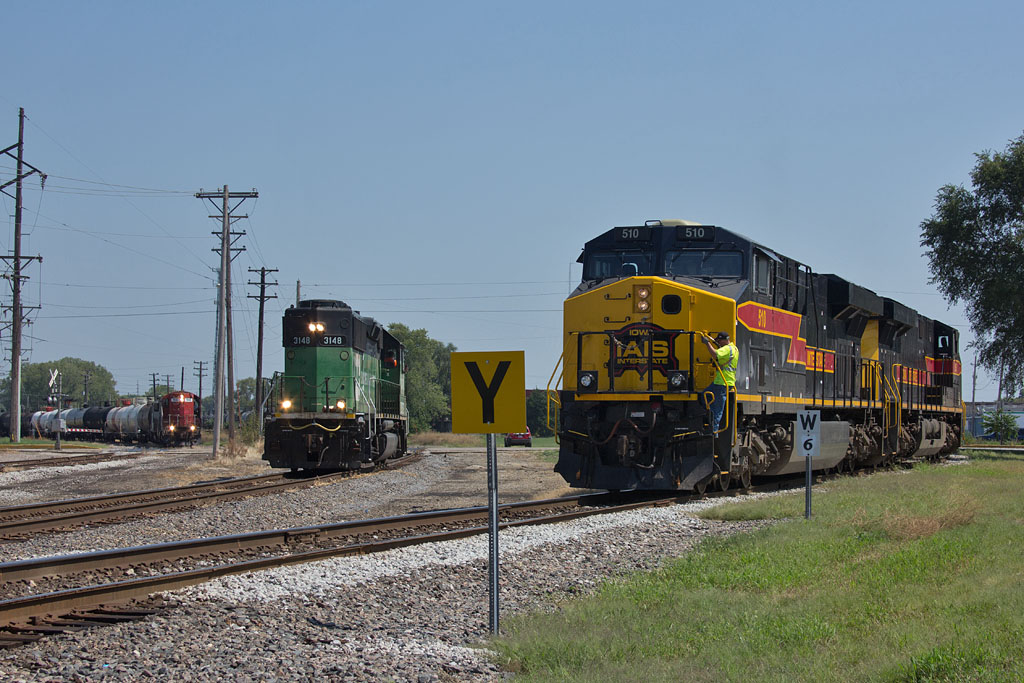ICE 114 holds clear of 7th Street while the IAIS and BNSF prepare to swap interchange. East Moline, IL.  August 30, 2012.
