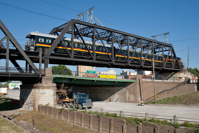 IAIS 717 & the business cars westbound on the Government Bridge; Davenport, IA.  July 11, 2012