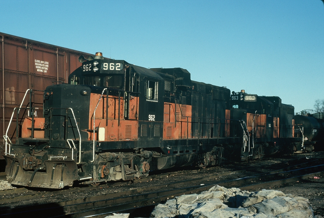 A pair of ex-Milwaukee GP20's 962 and 963  at Iowa City. Nov-1988.