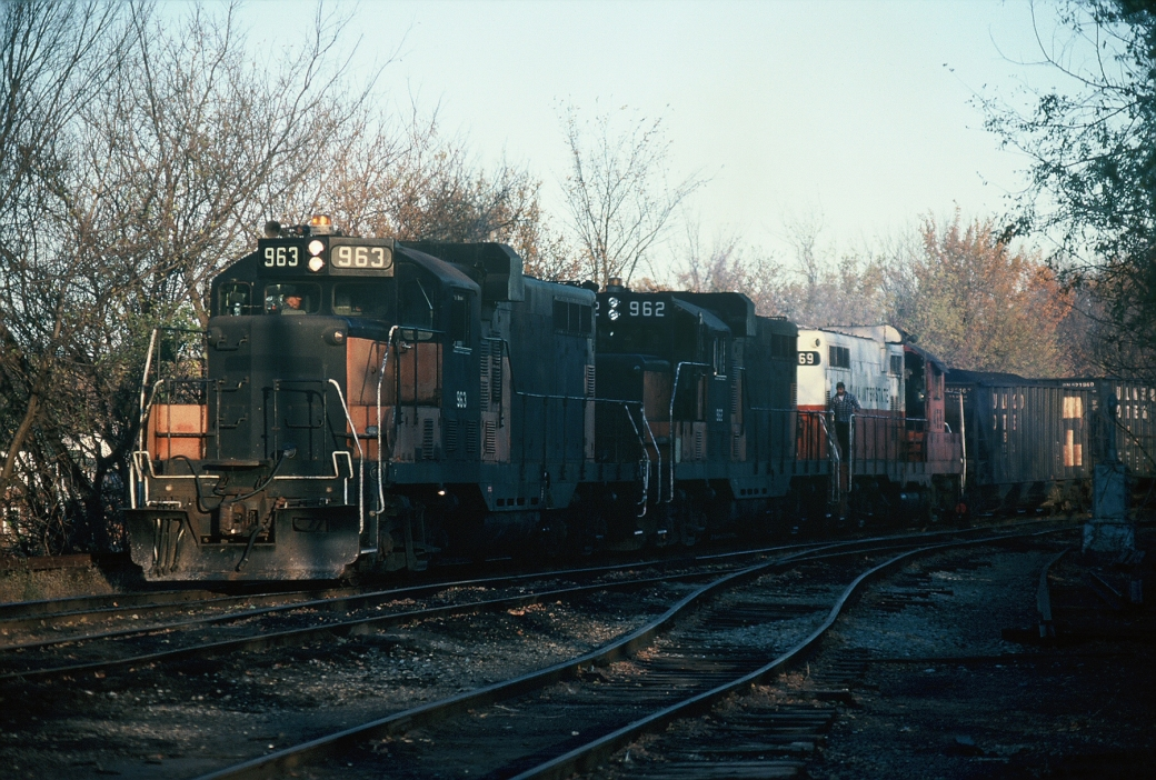 Ex-Milwaukees GP-20's 963 and 962 along with 469 getting ready to push a load of coal down the Hill Track to interchange with the CIC. Nov-1988.