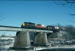 403, 464, ex-Milwaukee GP-20 962, and 466 cross the Iowa River Bridge in February 1989. I wonder if the guy fishing under the bridge ever thought his picture would be on the internet almost twenty years later?