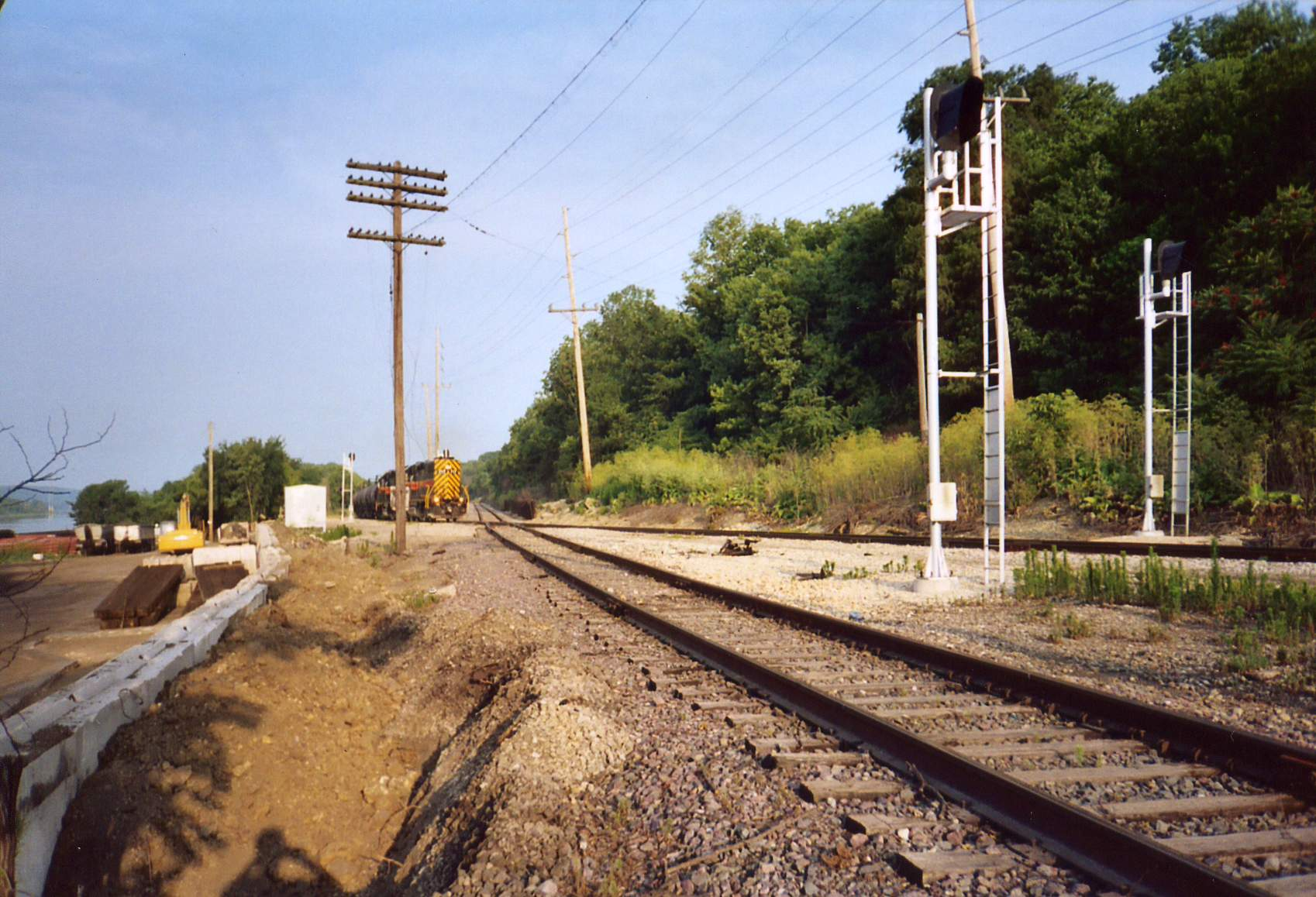 IAIS eastbound is about ready to cross the Ill. Railnet at Peru, June 28, 2005.