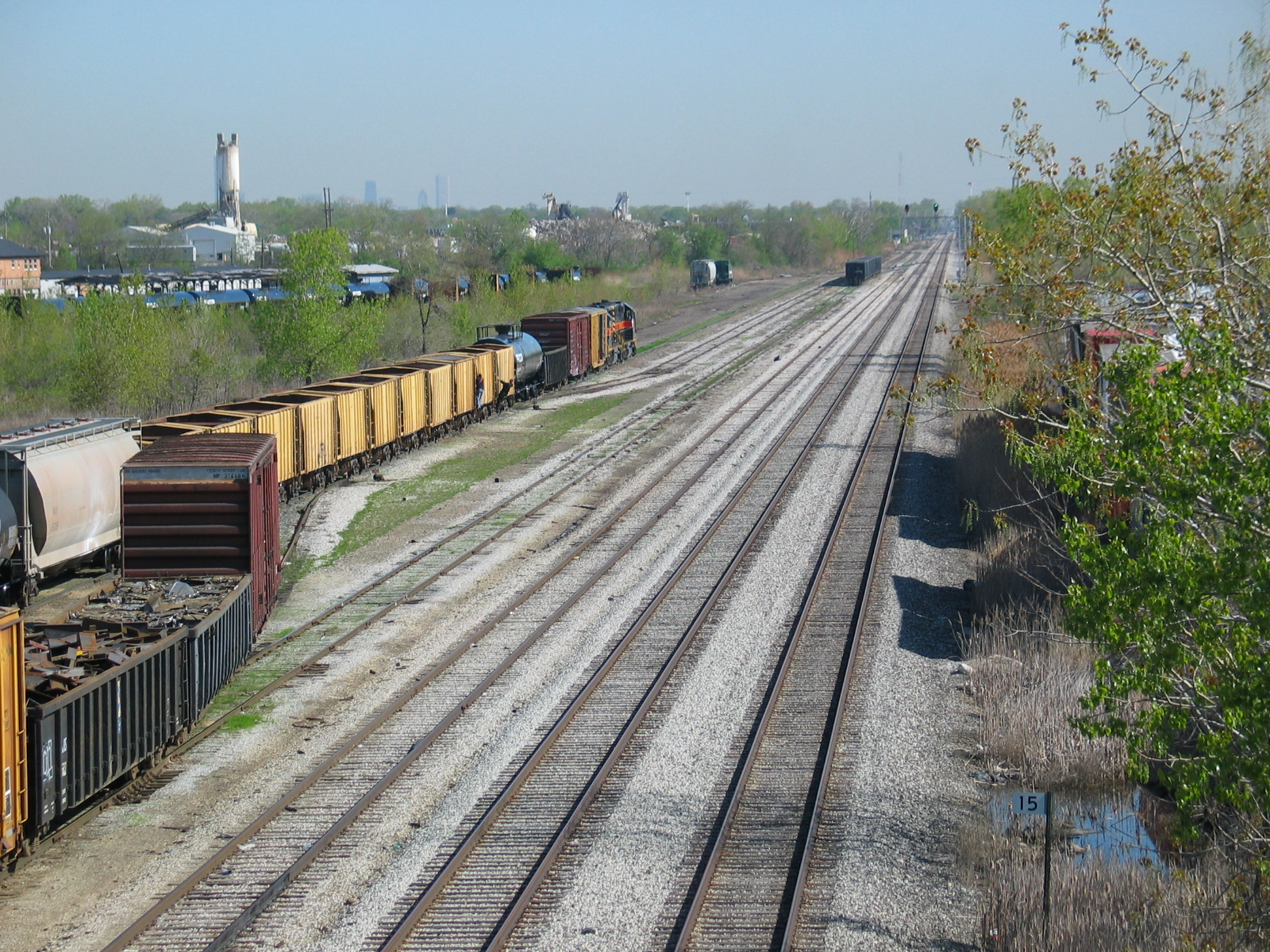 "IAIS's tracks at RI's old Burr Oak yard, looking north from the 127th st. overpass.  On the right is Metra's fomer RI ""mainline"" to downtown.  The Sears Tower would be visible if I hadn't put it behind that sand tower back there!  April 26, 2006."