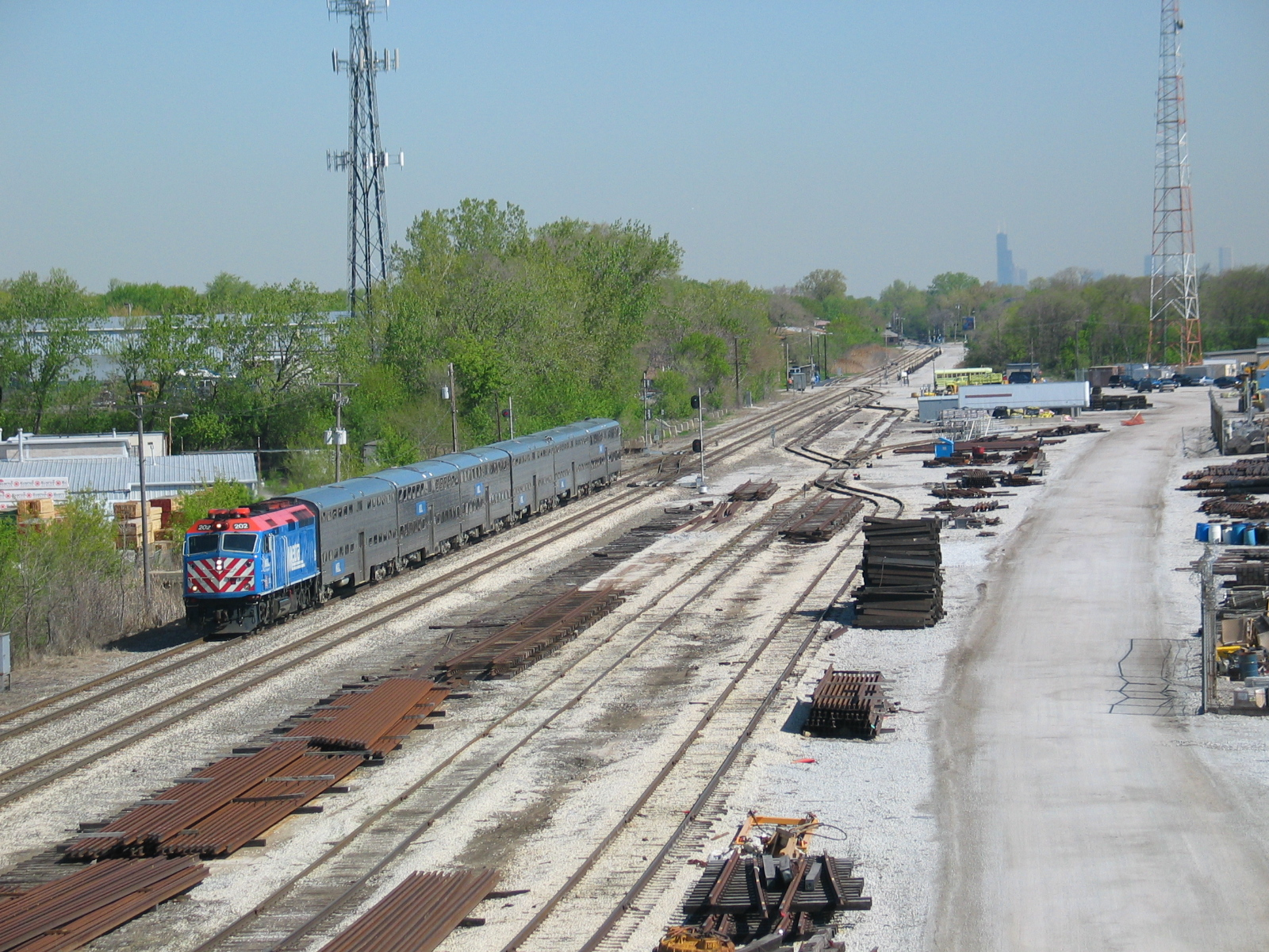 "Southbound Metra approaching the Prairie St. (127th) stop on the old RI ""suburban line.""  April 26, 2006.  This time you can see the Sears Tower!"