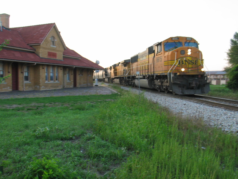 NS grain train passes West Lib. depot, Aug. 23, 2012.