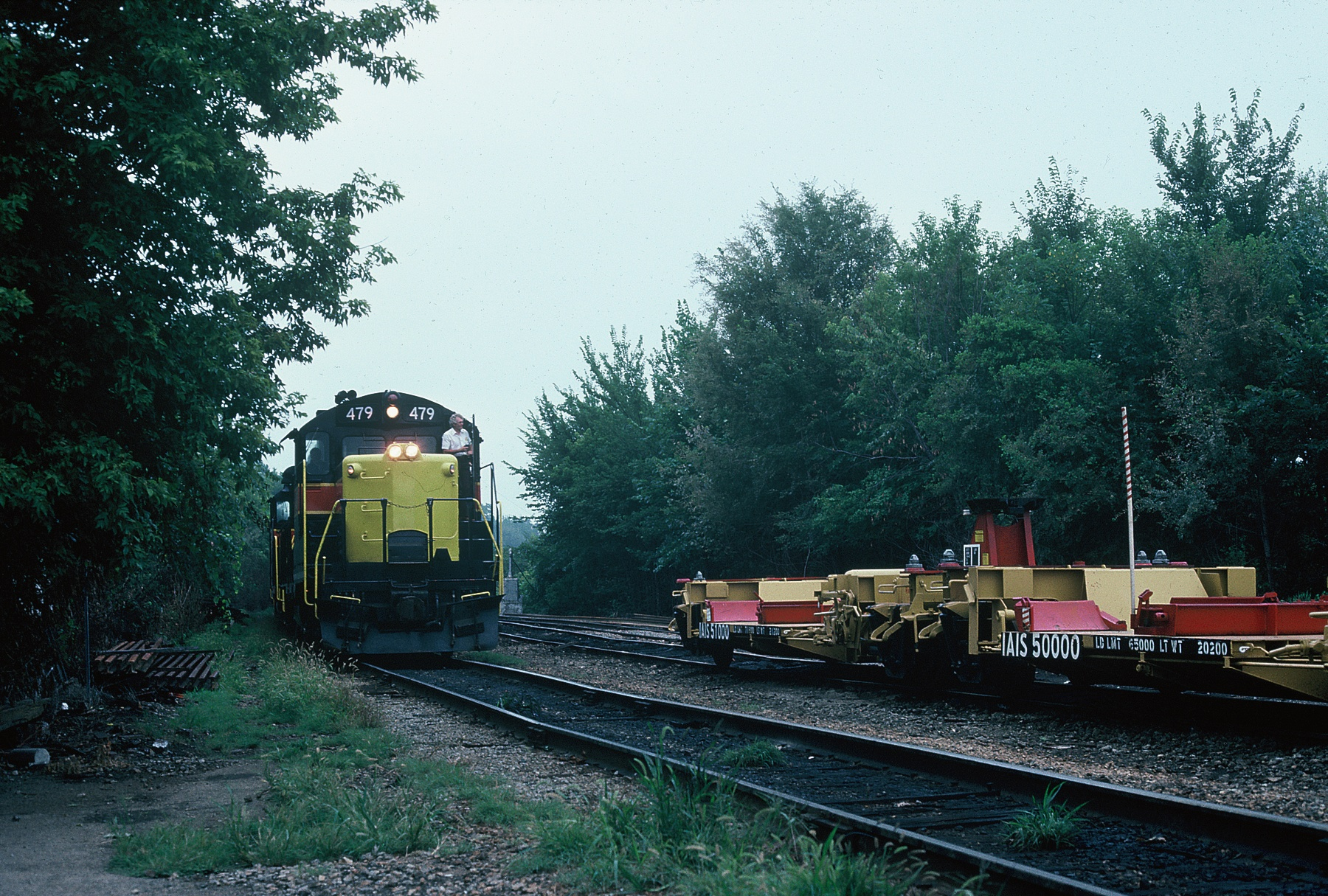 "State Fair Special arrives in Iowa City 8-20-88.  Note the infamous ""Trailer Railer"" cars parked on the siding."
