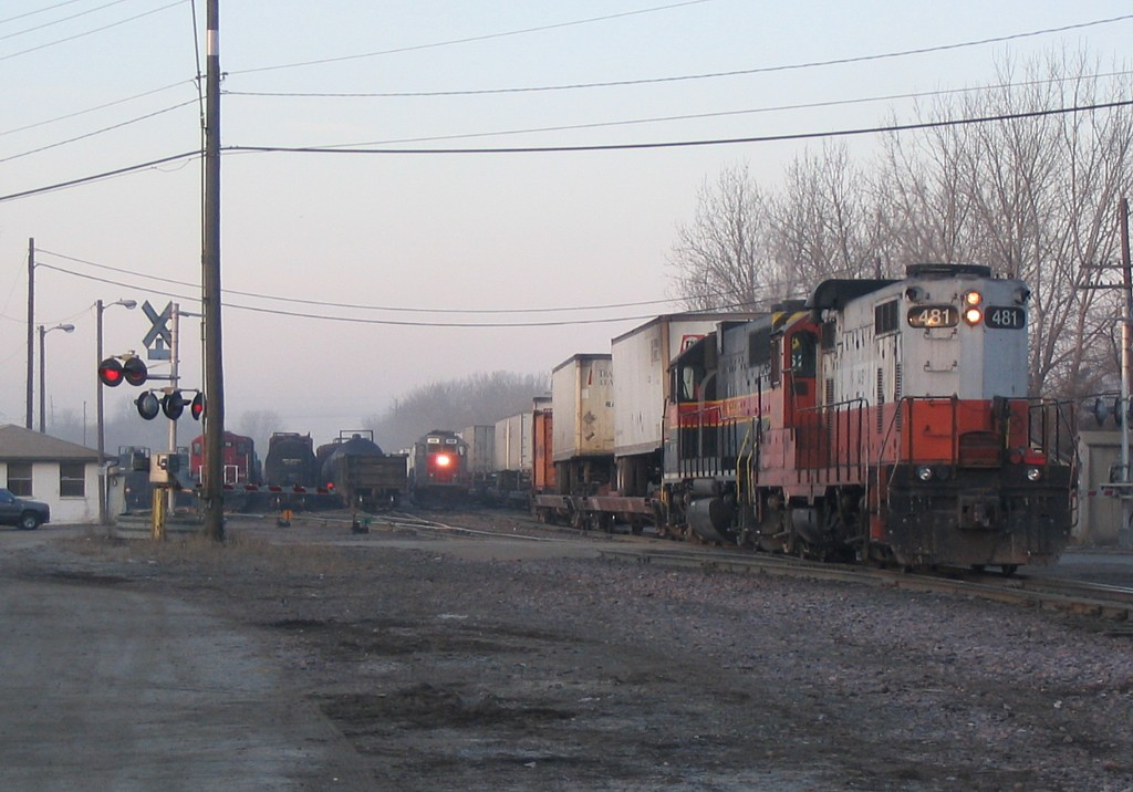 IAIS 481 is on the rear of the combined RIIC/BICB to pull the train back to the mainline.  West Davenport on 04-Mar-2005.