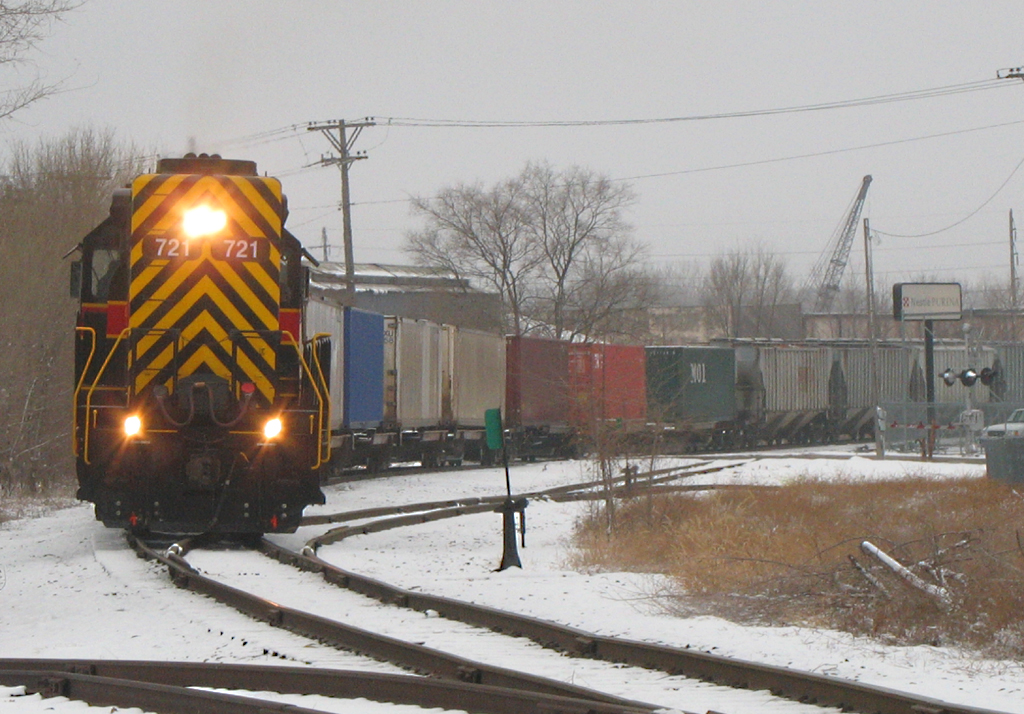 "RISW-22 assists BICB-21 detour by pulling the train east down the ""Golden State Route"" from IC&E's West Davenport yard back to the mainline at Taylor Street.  Photo at Rockingham Rd; Davenport, IA on 22-Jan-06."