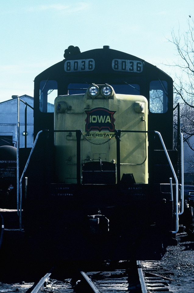 """A year later (04-Feb-1987) finds 8036 sitting in Iowa City. Note the upper red and white headlamps have been removed and the red hexagon emblem has been """"pasted over"""" with a new logo."""