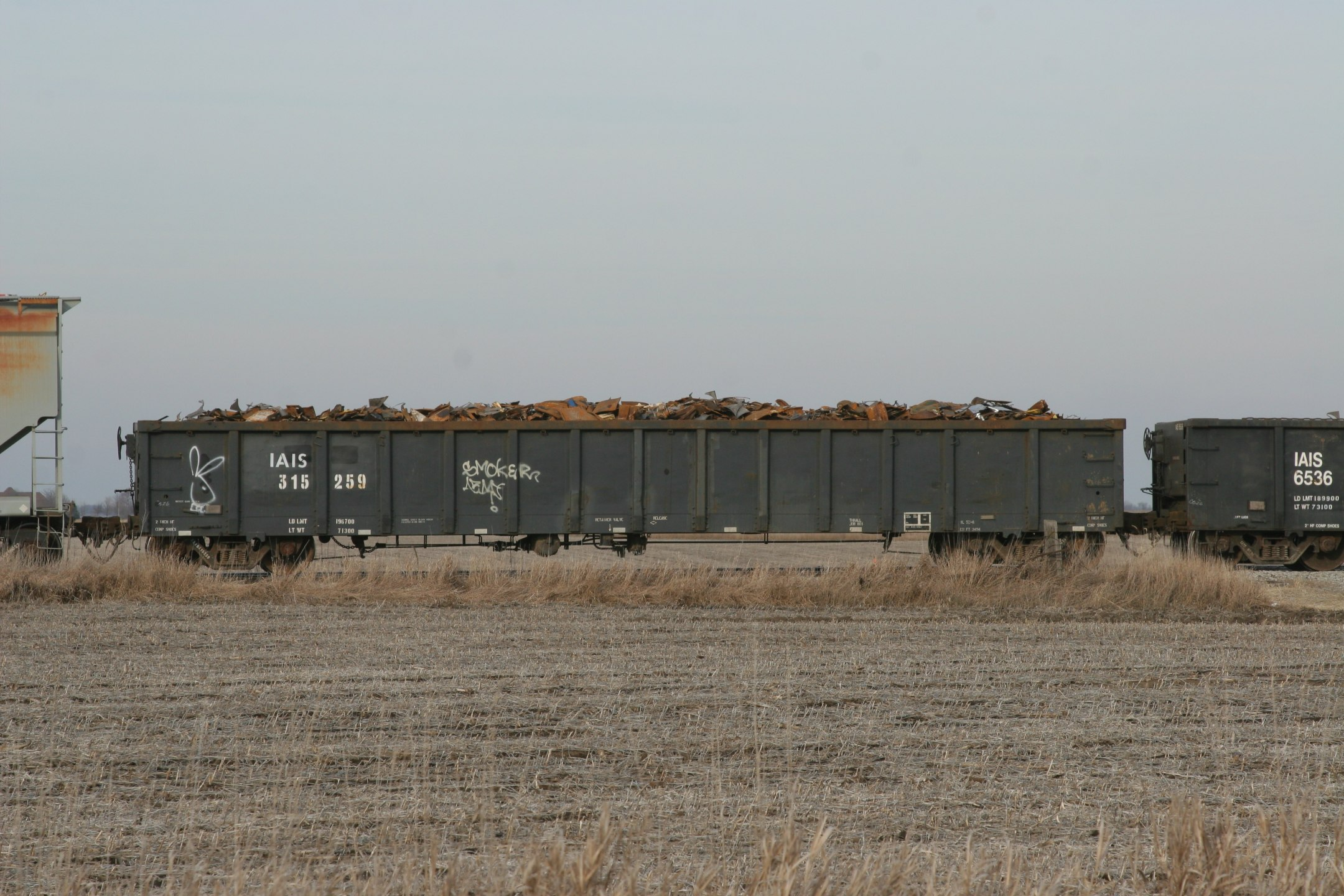IAIS 315259 eastbound on CBBI at Walcott, IA on 28-Dec-2006