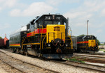 """IAIS 712 and business car """"Hawkeye"""" hold in Rock Island yard for the BNSF switcher to go by while the RISW works several tracks over on 26-Jul-2006."""