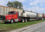 IAIS Volvo semi-tractor with flatbed trailer sits in Stockton, IA on 18-August-2005 during a crossing replacement project.