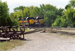 The east train swaps power in Iowa City.  Outbound power on the left, inbound on the right.  May 25, 2005.